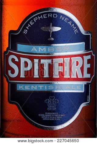 London, Uk - February 14, 2018: Cold Bottle Label Of Spitfire Amber Kentish Ale On White Background.