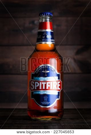 London, Uk - February 14, 2018: Cold Bottle Spitfire Amber Kentish Ale On Wooden Background.