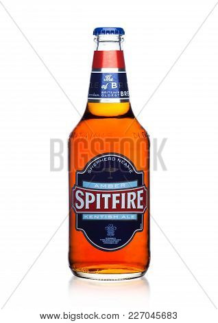 London, Uk - February 14, 2018: Cold Bottle Of Spitfire Amber Kentish Ale On White Background.
