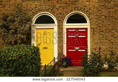 Two Vintage Georgian Doors Yellow And Red Colors In Dublin,ireland