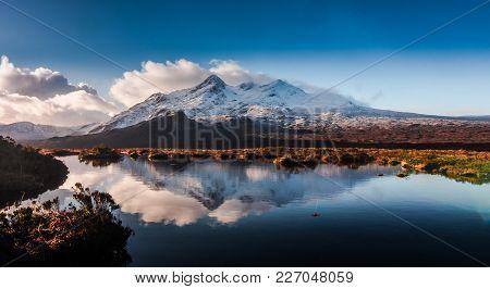 The Cuillin Ridge On The Isle Of Skye, Reflected In A Small Lochan, Down Glen Sligachan.