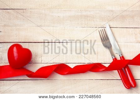 Valentines Day Background, Holiday Dinner, Knife, Fork, Red Heart, Silk Ribbon On White Wooden Table