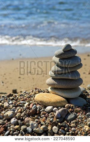 Relax Nature Concept On Sea. Spa Gray Stones Balance On Beach.