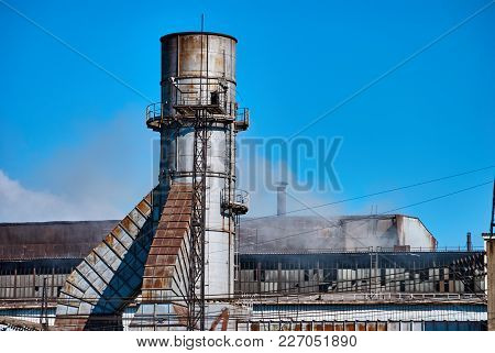 Metallurgical Plant Against The Blue Sky