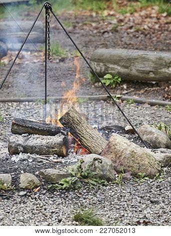 Outdoor Pioneer Cooking On Open Fire In Frontier Fort