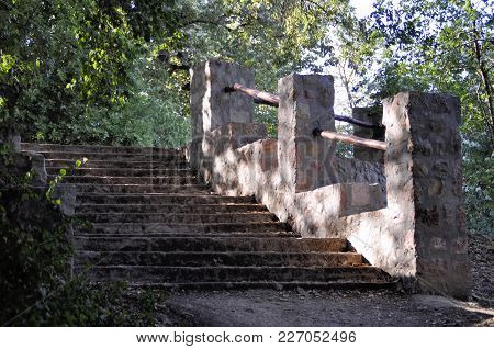 Old  Staircase With High Solid Handrails Outdoor Leading Up.  Ancient Architecture.