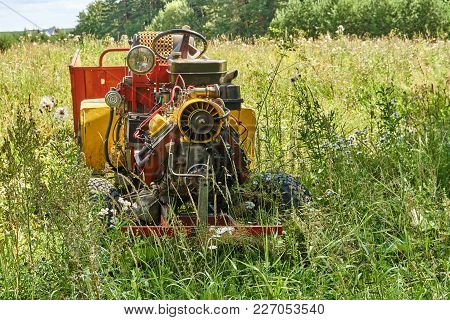 Homemade Tractor In High Grass