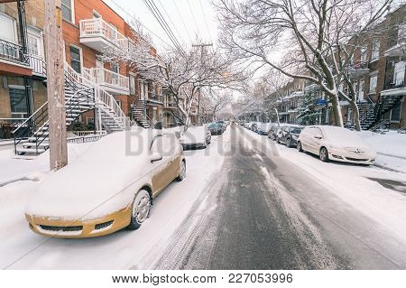 Montreal, Ca - 17 February 2018: Cars And Trees Covered In Snow On Bordeaux Street