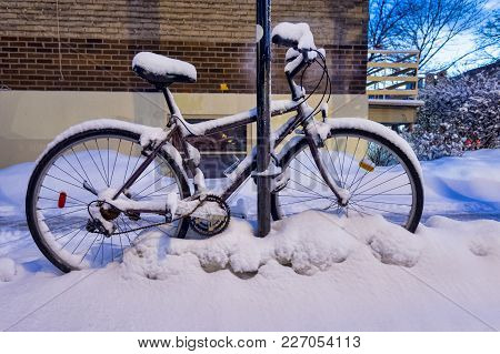 Bike Covered In Snow During Snow Storm