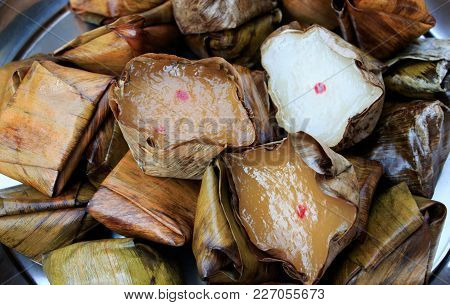 Chinese Sweetmeat Steamed Dessert In Banana Leaf Basket For Celebration In Chinese New Year For Pay