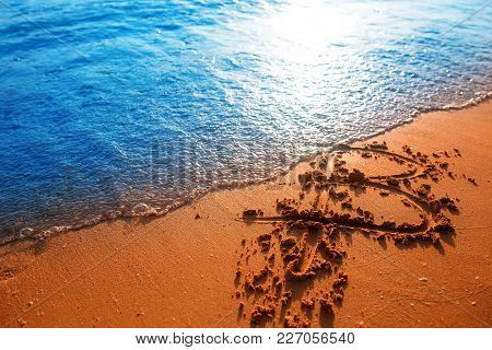 Bitcoin. Bitcoin On Golden Sand, In Background Sea. Concept Collapse Of Bitcoin, Soap Bubble Burst,