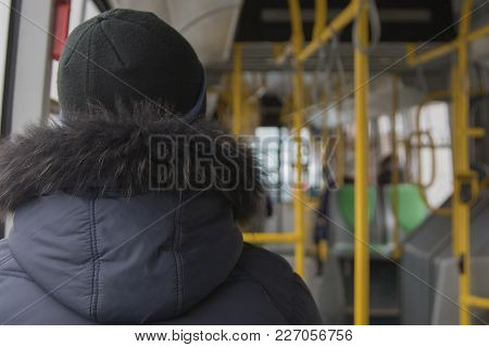 People In Public Transport In Bad Weather