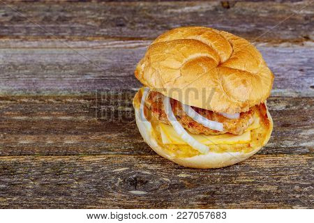 Burger On Wooden Background. Vintage Home Made Burger. Fast Food Meal. American Food. Homemade Grill