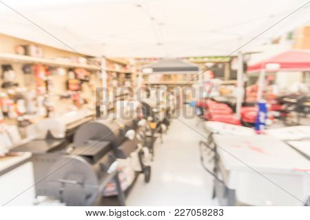 Blurred Grills And Outdoor Cooking Tools At Sporting Goods Store In America