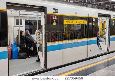 Tehran, Iran - April 29, 2017: Women In Islamic Hijabs Are Sitting In The Subway Train, The View Fro