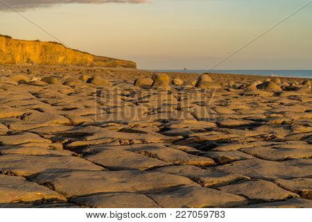 The Stones And Cliffs Of Llantwit Major Beach In The Evening Sun, South Glamorgan, Wales, Uk