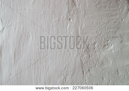 Light Textured White Plaster With A Fissures