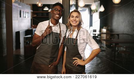 Café Owners At Their Coffee Shop