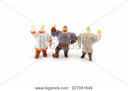 Russia Three Heroes Toys On White Background