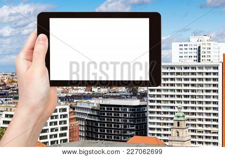 Travel Concept - Tourist Photographs Berlin City In Germany In September On Tablet With Cut Out Scre