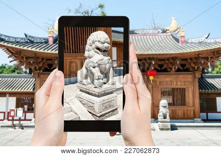 Travel Concept - Tourist Photographs Lion Statue Near Entrance To Guangxiao Buddhist Temple (bright