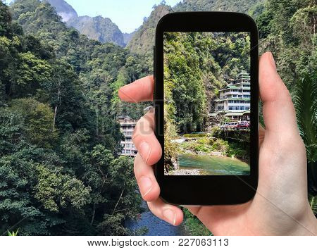 Travel Concept - Tourist Photographs Mountain Brook In Longsheng Hot Springs National Forest Park In