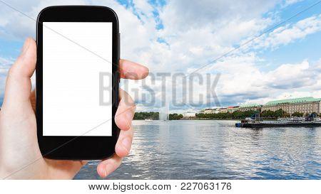Travel Concept - Tourist Photographs Binnenalster (inner Alster Lake) With Fountain In Hamburg City