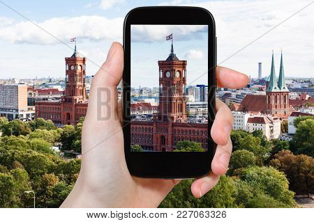 Travel Concept - Tourist Photographs Rotes Rathaus (red City Hall) In Berlin City On Smartphone