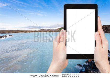 Travel Concept - Tourist Photographs Blue Lagoon Geothermal Lake In Grindavik Lava Field Outside Spa