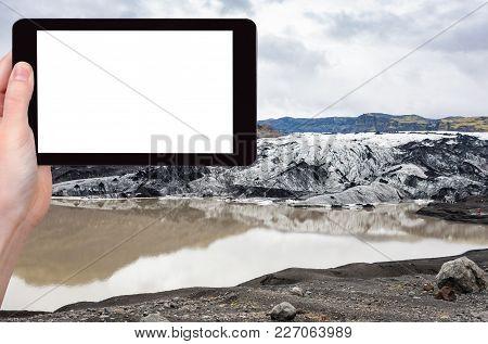 Travel Concept - Tourist Photographs Solheimajokull Glacier (south Glacial Tongue Of Myrdalsjokull I