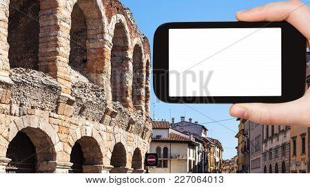 Travel Concept - Tourist Photographs Arena Di Verona Ancient Roman Amphitheatre In Verona City On Sm