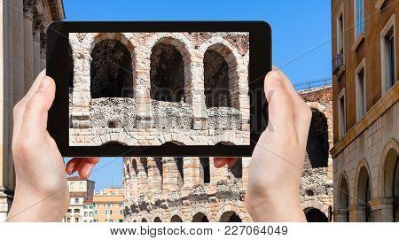 Travel Concept - Tourist Photographs Wall Of Arena Di Verona Ancient Roman Amphitheatre In Verona Ci