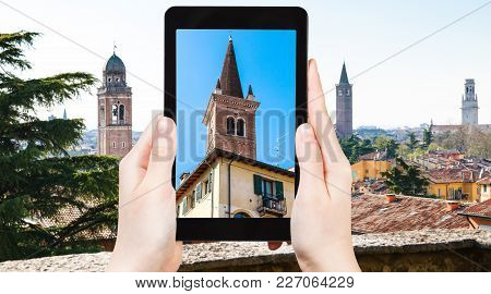 Travel Concept - Tourist Photographs Towers Of Verona City In Italy In Spring On Tablet