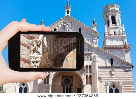 Travel Concept - Tourist Photographs Duomo Cathedral In Verona City (cattedrale Santa Maria Matricol