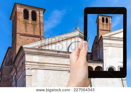 Travel Concept - Tourist Photographs Chiesa Di San Sebastiano With Tower On Via Giovanni Acerbi In M