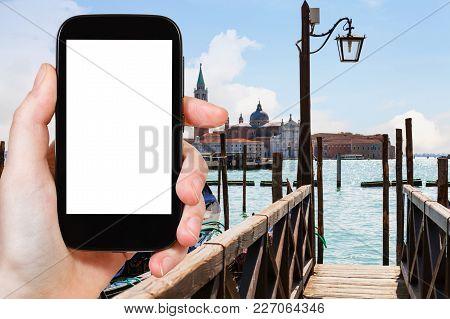 Travel Concept - Tourist Photograps San Giorgio Maggiore Island From Pier In Venice City In Italy In