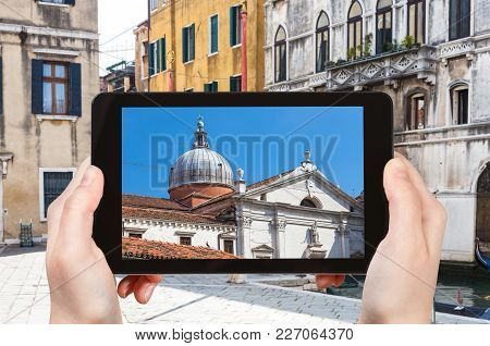 Travel Concept - Tourist Photographs Church Chiesa Santa Maria Formosa From Canal In Venice City In