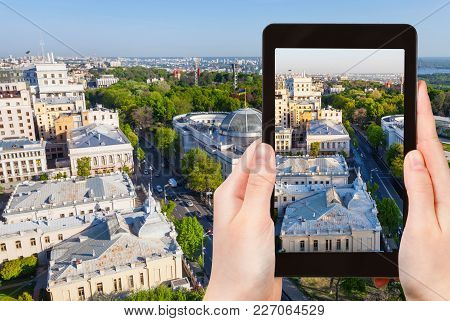 Travel Concept - Tourist Photographs Verkhovna Rada Building (parliament House) On Hrushevsky Street