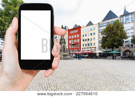 Travel Concept - Tourist Photographs Old Market (alter Markt) Square In Cologne City In Germany In S