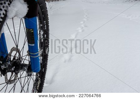 Front Wheel Of Mountain Bike Stay In Snow.
