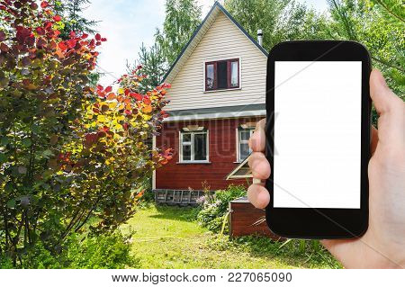 Travel Concept - Tourist Photographs Simple Wooden Cottage And Well On Backyard In Russian Village I