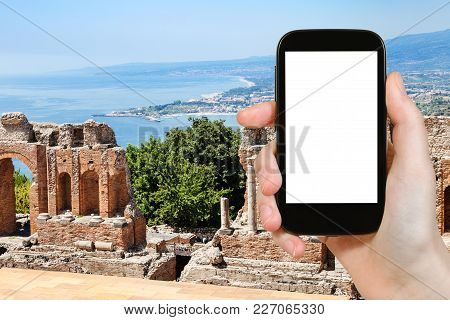 Travel Concept - Tourist Photographs Ruined Ancient Greek Theater (teatro Greco) In Taormina City In