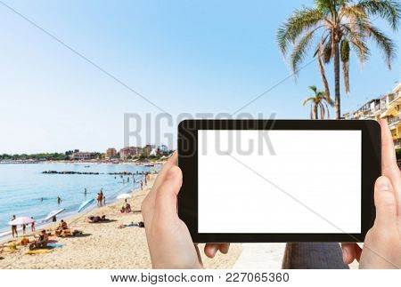 Travel Concept - Tourist Photographs Urban Sand Beach In Giardini-naxos Town In Sicily Italy In Summ