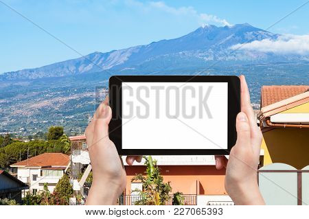 Travel Concept - Tourist Photographs Residential Houses In Giardini-naxos Town And Etna Mount In Sic