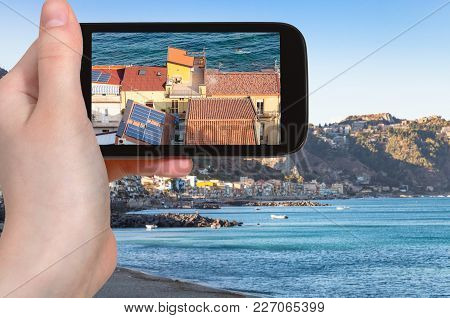 Travel Concept - Tourist Photographs Residential Houses In Giardini Naxos Town On Coast Of Ionian Se