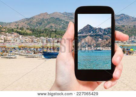 Travel Concept - Tourist Photographs Taormina City On Cape And In Giardini Naxos Town On Coast Of Io