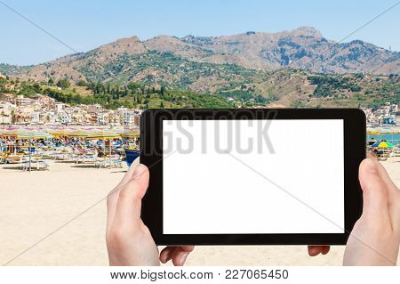 Travel Concept - Tourist Photographs City Sand Beach In Giardini-naxos Town In Sicily Italy In Summe