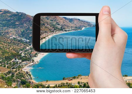 Travel Concept - Tourist Photographs Letojanni Resort Town Of Coast Of Ionian Sea From Taormina City