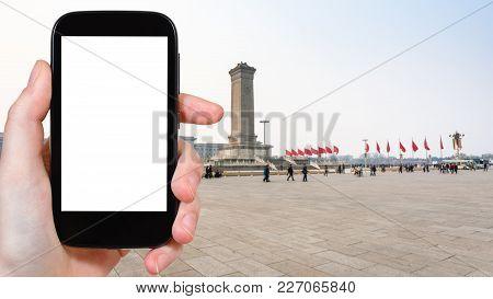 Tourist Photographs Tiananmen Square In Beijing
