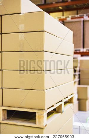 Stack Of Boxes And Cartons On Wooden Pallet In Warehouse